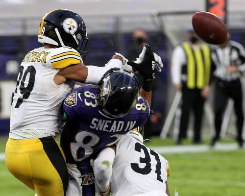 BALTIMORE, MARYLAND - NOVEMBER 01: Free safety Minkah Fitzpatrick #39 and cornerback Justin Layne #31 of the Pittsburgh Steelers hit wide receiver Willie Snead #83 of the Baltimore Ravens on the last play of the game during the Steelers 28-24 win at M&T Bank Stadium on November 01, 2020 in Baltimore, Maryland. (Photo by Patrick Smith/Getty Images)
