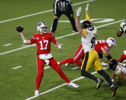 Buffalo Bills quarterback Josh Allen (17) gets off a pass under pressure by Pittsburgh Steelers outside linebacker T.J. Watt (90) during the first half of an NFL football game in Orchard Park, N.Y., Sunday, Dec. 13, 2020. (AP Photo/Jeffrey T. Barnes )