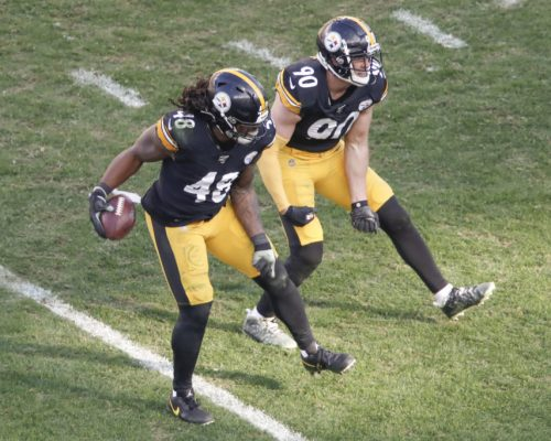 Pittsburgh Steelers outside linebacker Bud Dupree (48) celebrates with T.J. Watt (90) after recovering the fumble he caused with a strip sack of Indianapolis Colts quarterback Brian Hoyer (2) before revering the fumble during the second half an NFL football game, Sunday, Nov. 3, 2019, in Pittsburgh. (AP Photo/Gene J. Puskar)